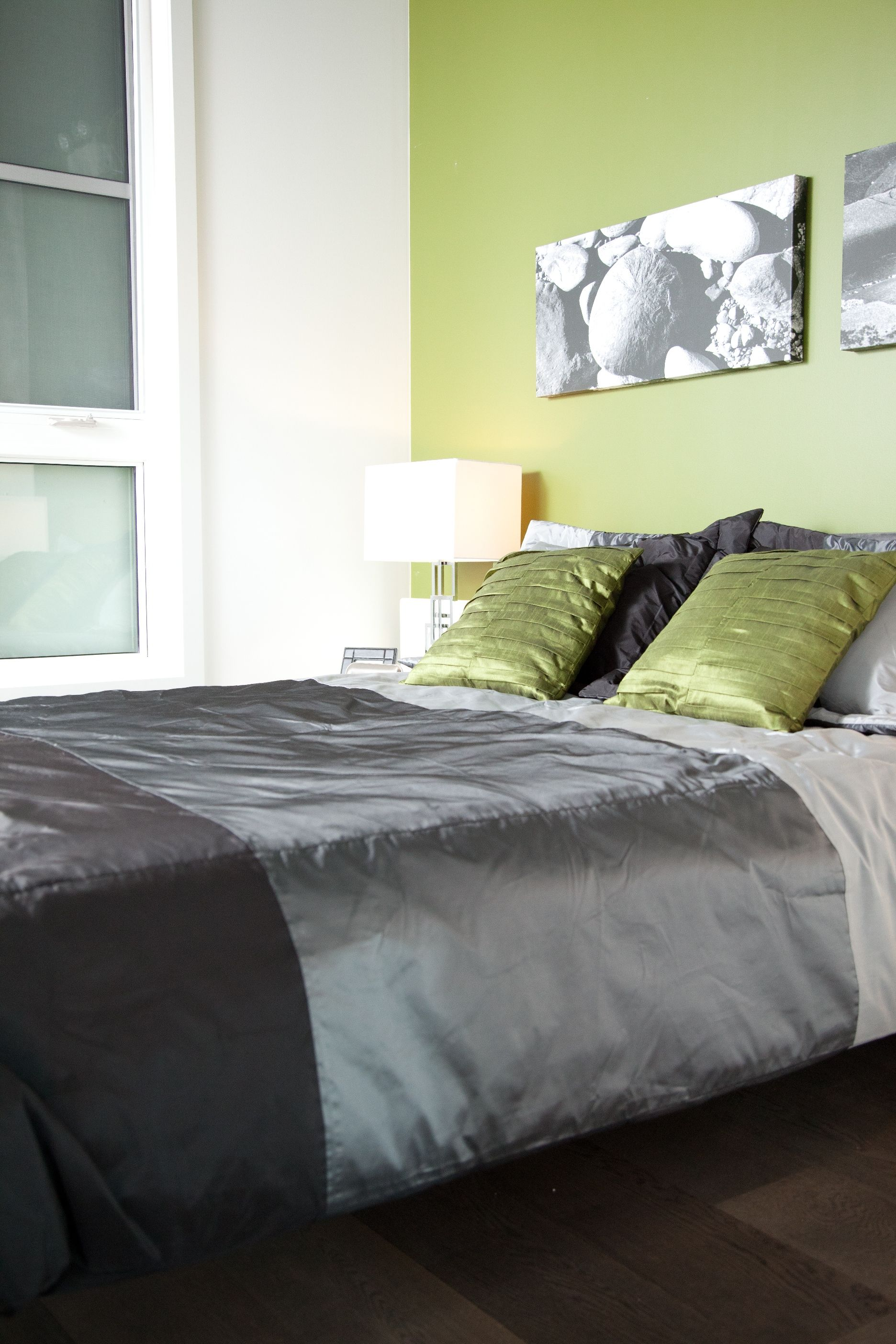 Modern apartment bedroom with green walls oversized windows grey