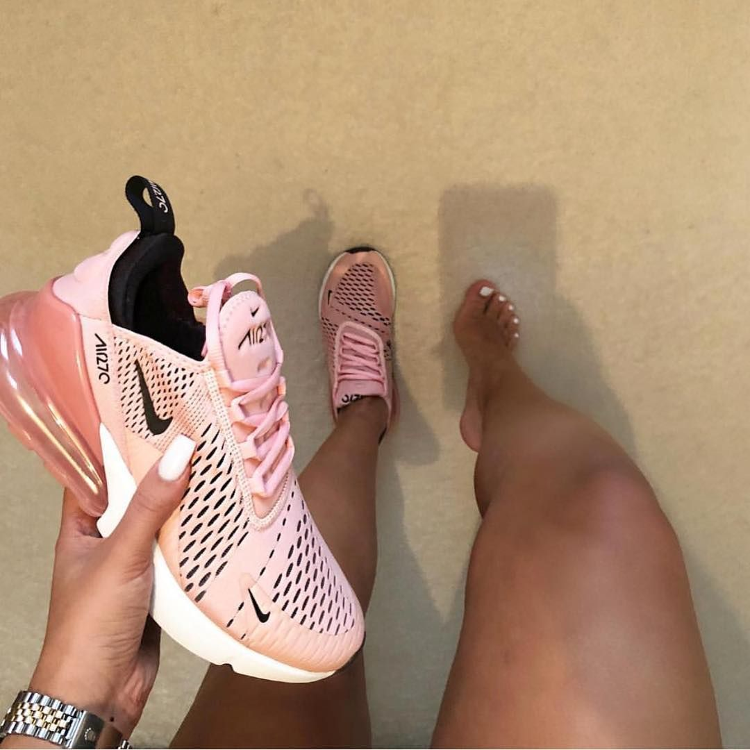d11ad7962 Nike Air Max 270 pink white black shoes. 2018 Nike sneakers. Worn by woman  on beach with suntan.