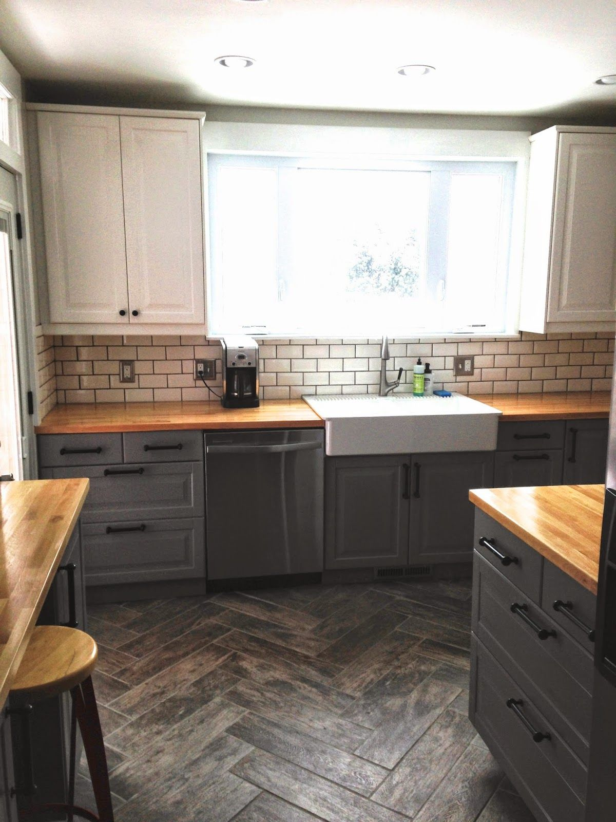 "Before & After: ""Single Wide"" Kitchen Opens Up  The floor, Grey and Double sinks"