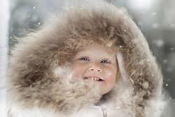 Winter child in hooded parka