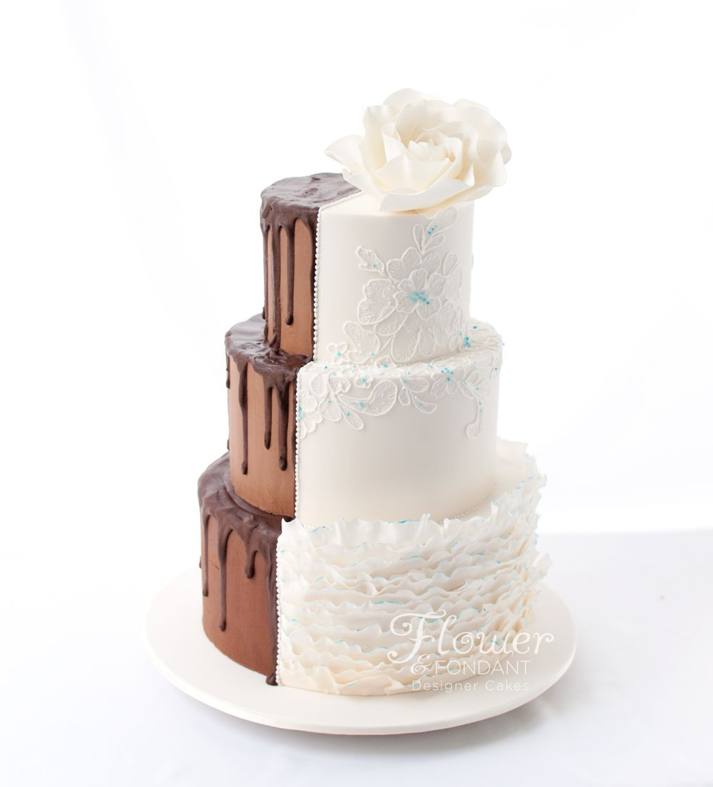 He wanted something simple, she wanted something pretty. And they both got their wish! Hand piped lacework to match the brides dress and touches of Tiffany blue which was the feature colour of the wedding adorn the brides side. While a naked ganache finish with dark chocolate ganache drizzle make for a delicious grooms side. Top two tiers were hazelnut Frangelico mud cake with layers of Nutella ganache and the bottom tier was a dark mint mud.
