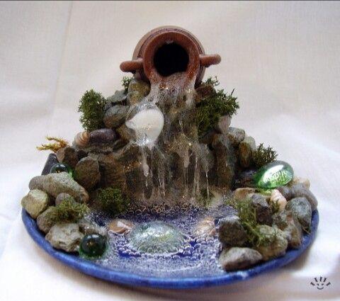 Поделка из ракушек и камней водопад