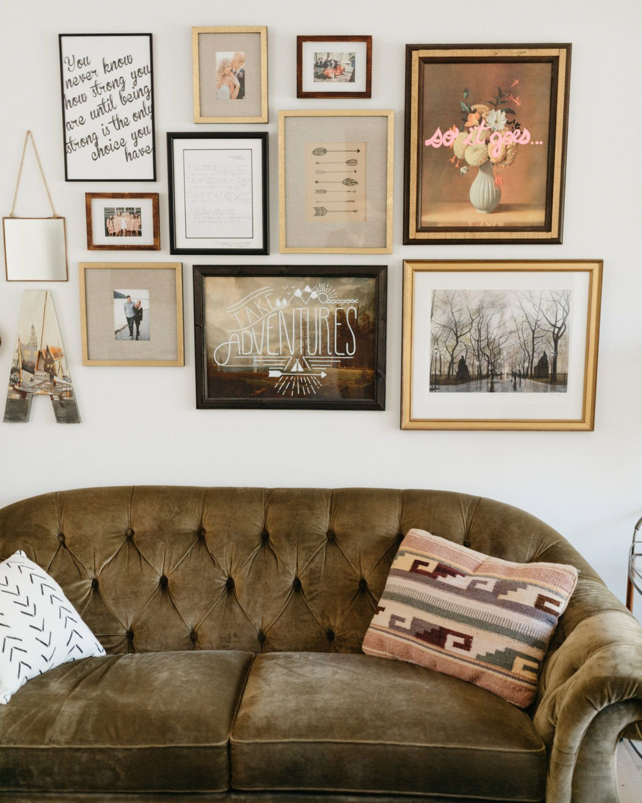 Design showcase natalies cozy eclectic montana living room apartments the combination of black natural wood and metallic gold frames jeuxipadfo Image collections
