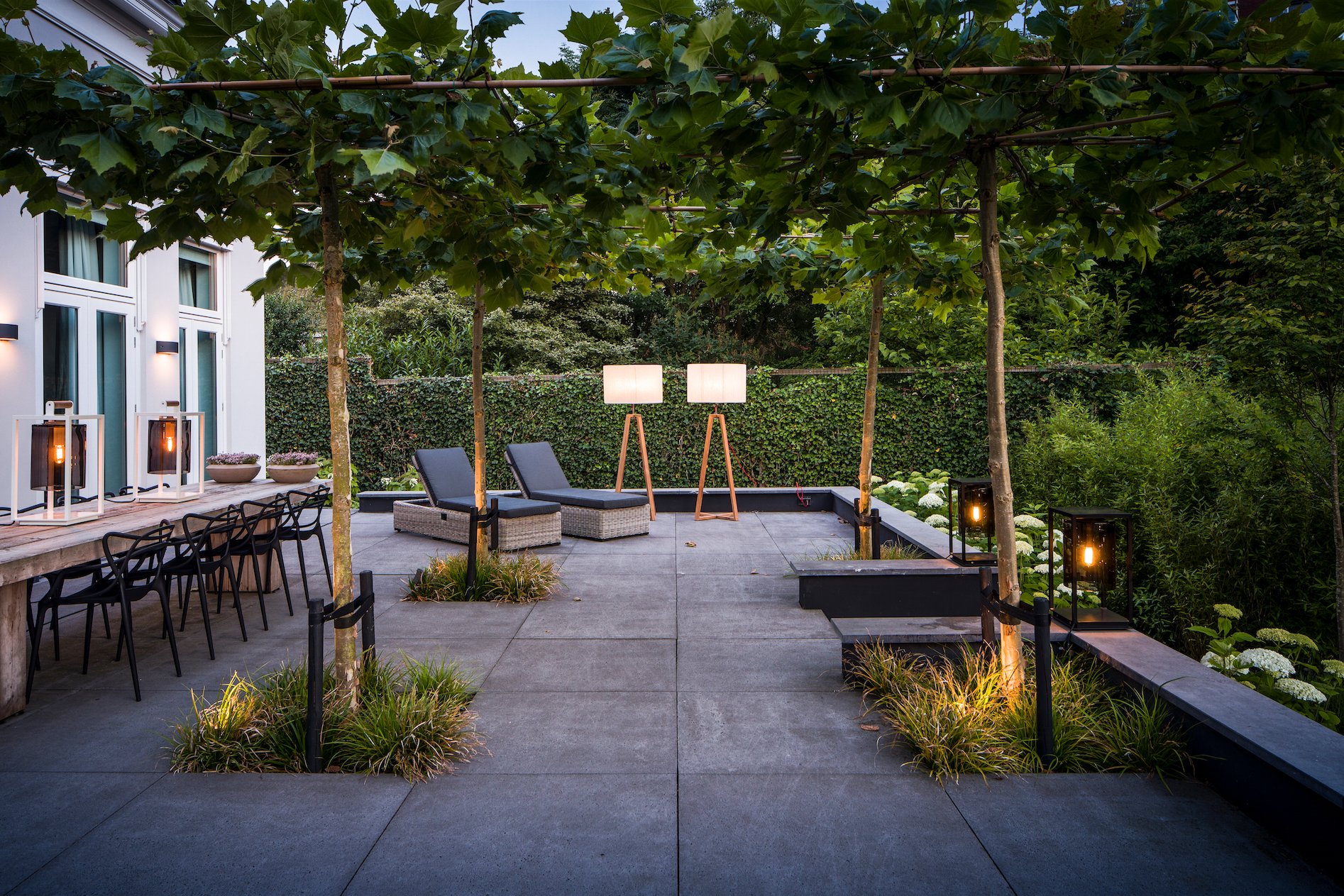 Roof terrace with concrete tiles and shaped trees for Terrace trees
