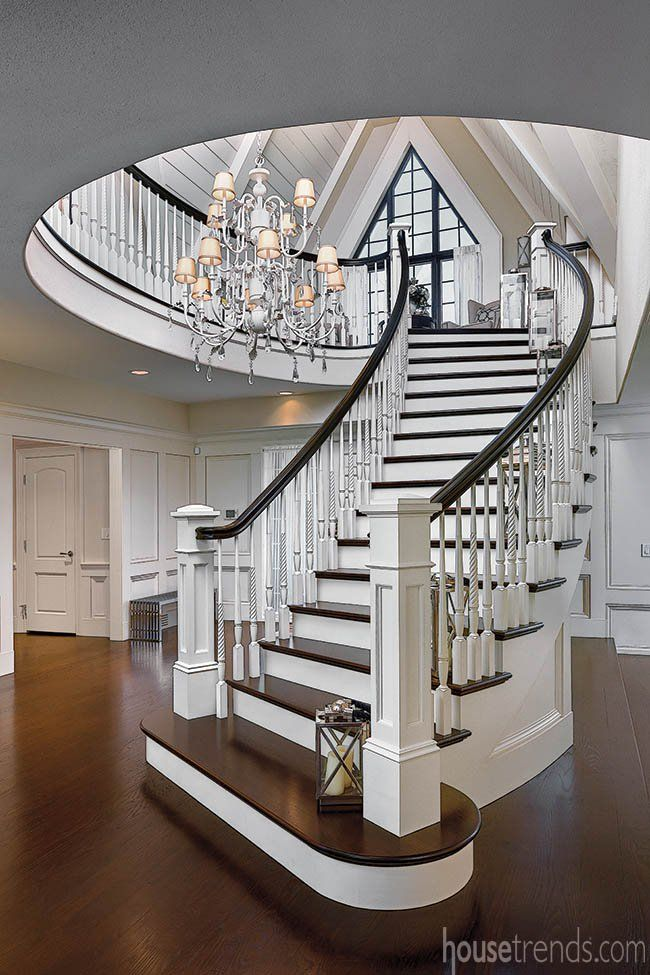 A Grand Staircase With A Gorgeous Chandelier And Lanterns