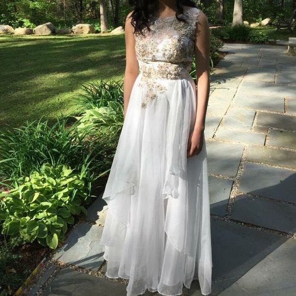 """White floor length prom dress White floor length prom dress with floral appliqués and beading. Size x-small. For reference of sizing, I'm 5'3"""", 110lbs and am pictured in the dress. Dresses Prom"""