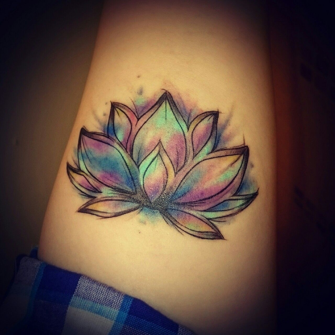 My new tattoo. It's a lotus The flower retreats back into