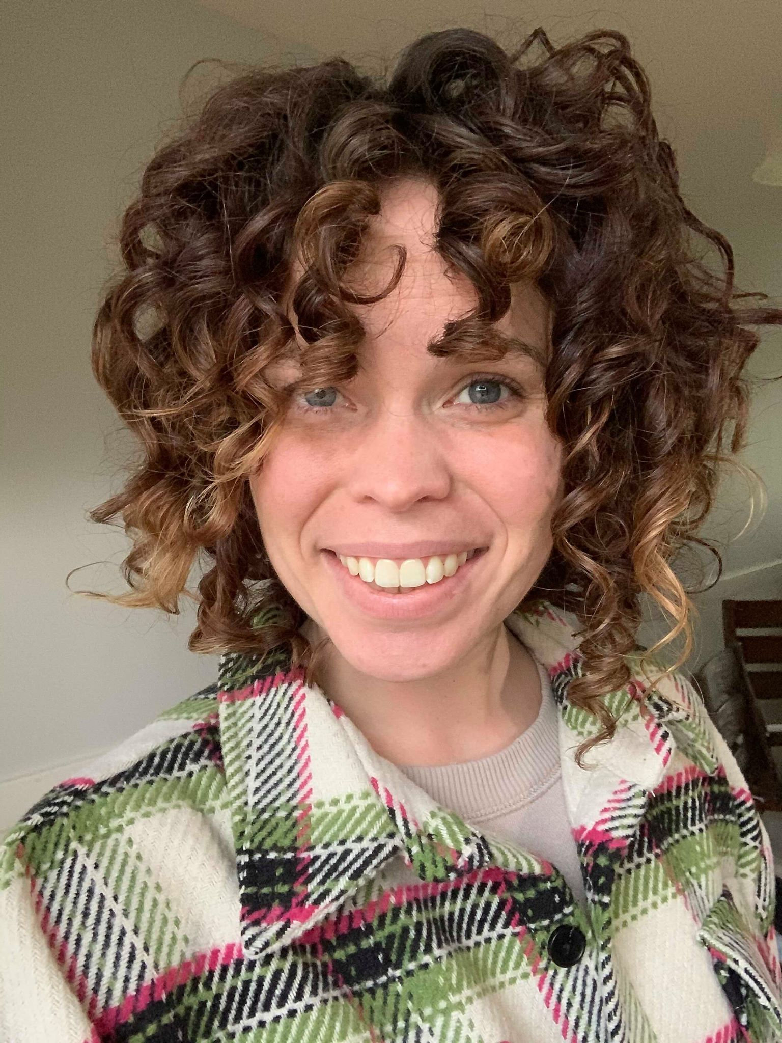 5 Things To Consider Before You Get Curly Bangs Colleen Charney In 2020 Curly Hair Styles Frizz Free Curly Hair Curly Bangs
