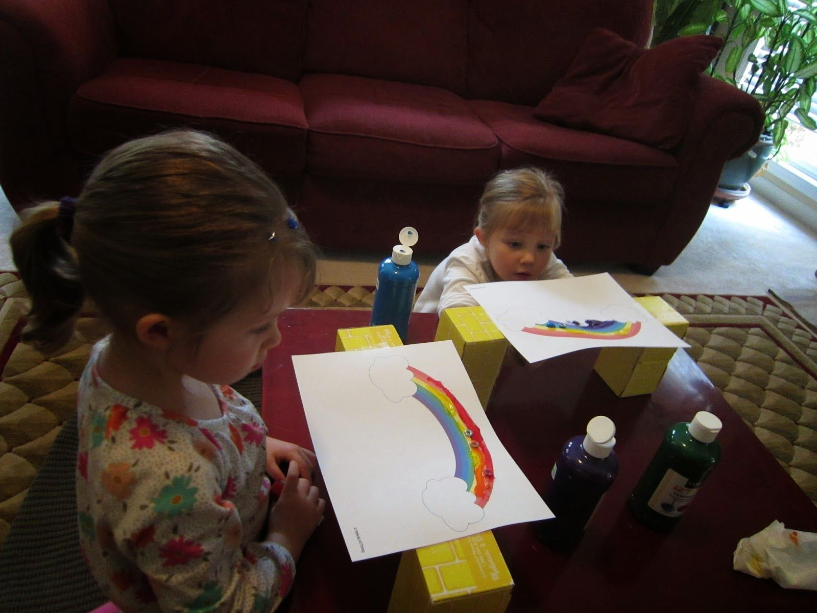 Make Magnetic Rainbow Masterpieces while learning about magnets, rainbow colors, and developing fine motor skills!