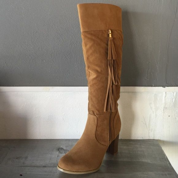 Tan Knee High Boots 3 inch heel. Tan, never used, has fringe on zipper. Feel free to ask questions or make me an offer Shoes Heeled Boots