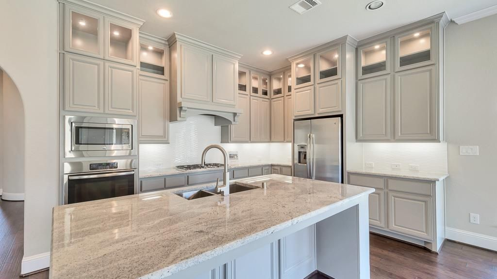 add a second row of glass-faced cabinets with crown ...