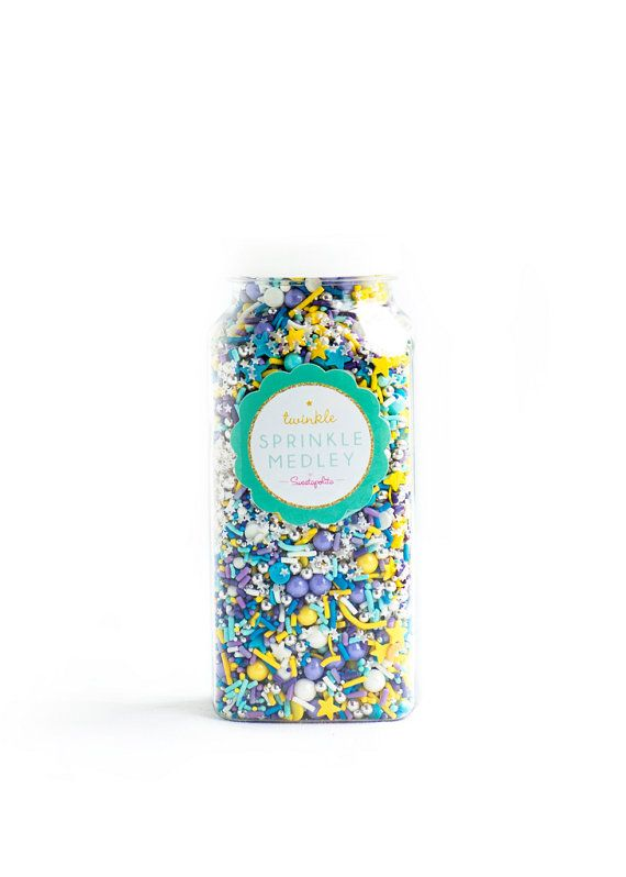STELLAR Twinkle Sprinkle Medley is a premium, one of a kind mix of some of the prettiest and most stellar starry sprinkles in the universe: purple/lavender/turquoise/ yellow/white jimmies, edible silver dragées, edible silver stars, star quins, glossy sixlets, shimmery candy beads, sparkling sugar, nonpareils and more. Perfect for anything from a stylish wedding cake or party cake to wintery party treats and everything in between. All of the sprinkles in this mix are candy-sweet and yummy on…
