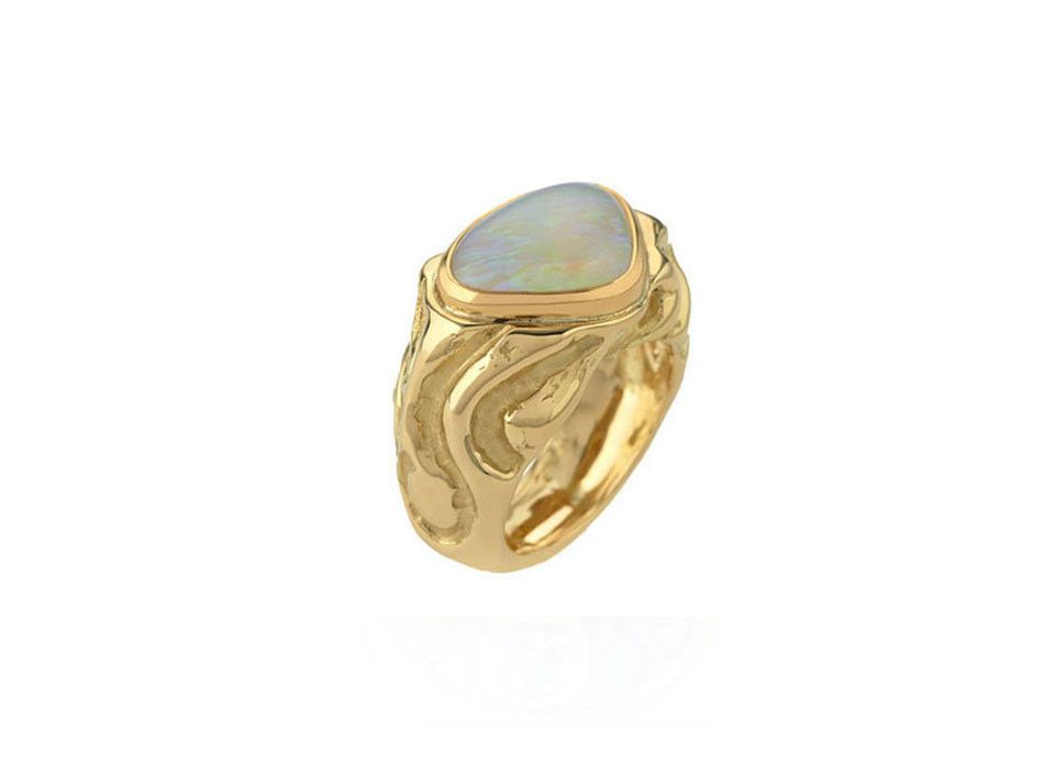 ELIZABETH GAGE Molten Gold Opal Ring 18ct molten gold ring set with a rounded triangular shaped cabochon opal