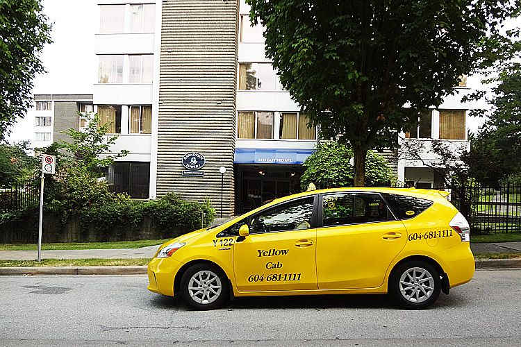 Yellow Cab Owner Operator waiting for pickup at Grandview Towers