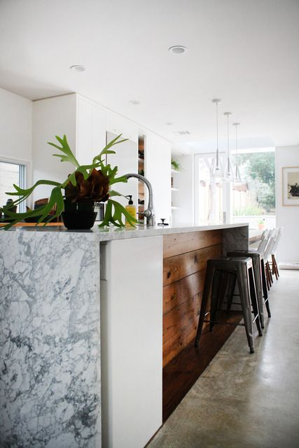 exposed marble waterfall detail on kitchen island/ counter seating