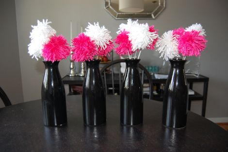 Cute centerpiece idea!! Yarn Pom Poms!!! This blog has the simple tutorial...