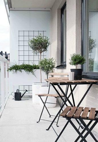 Photo of Scandinavian minimalism in balcony garden design.