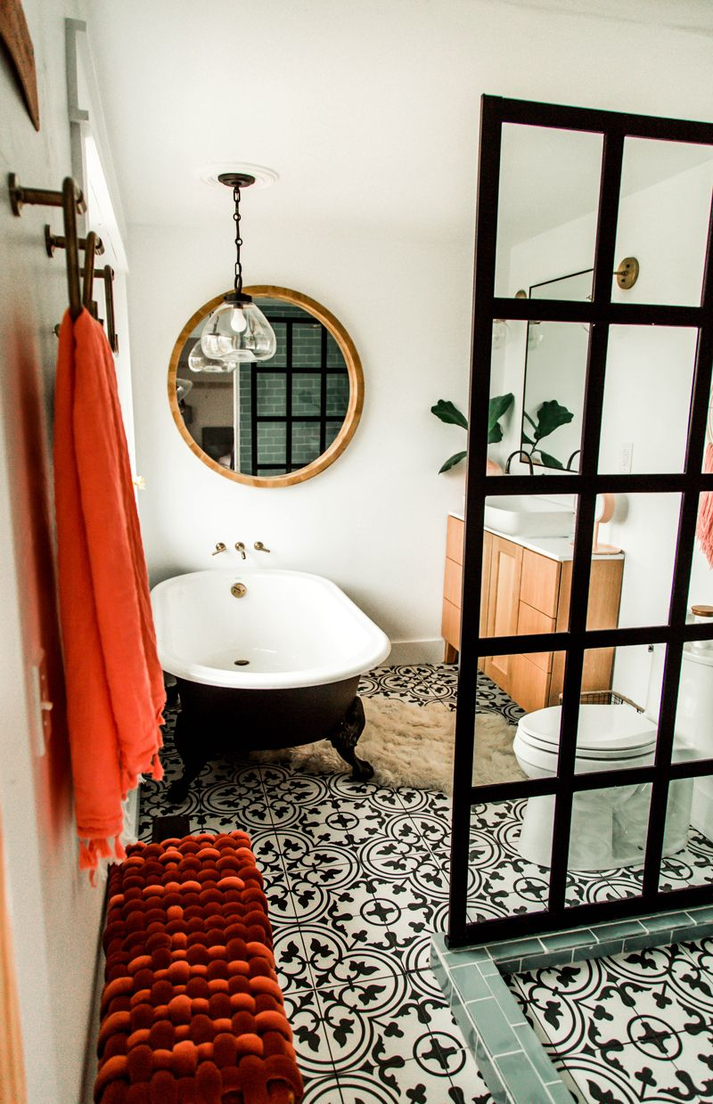 Ethnic tile floors with bright accents really into the bright towels mixed with the rest