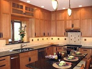 Kitchen Cabinets Wood Colors medium color cabinets, dark countertops, warm tans at the