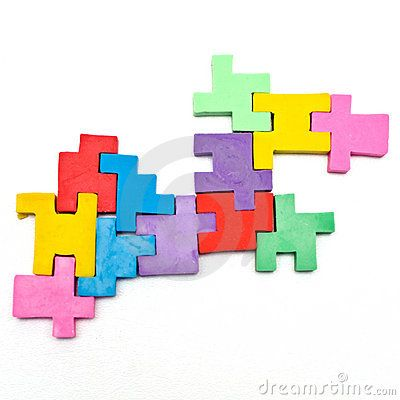 Colorful pieces of a rubber jigsaw puzzle on a white background.