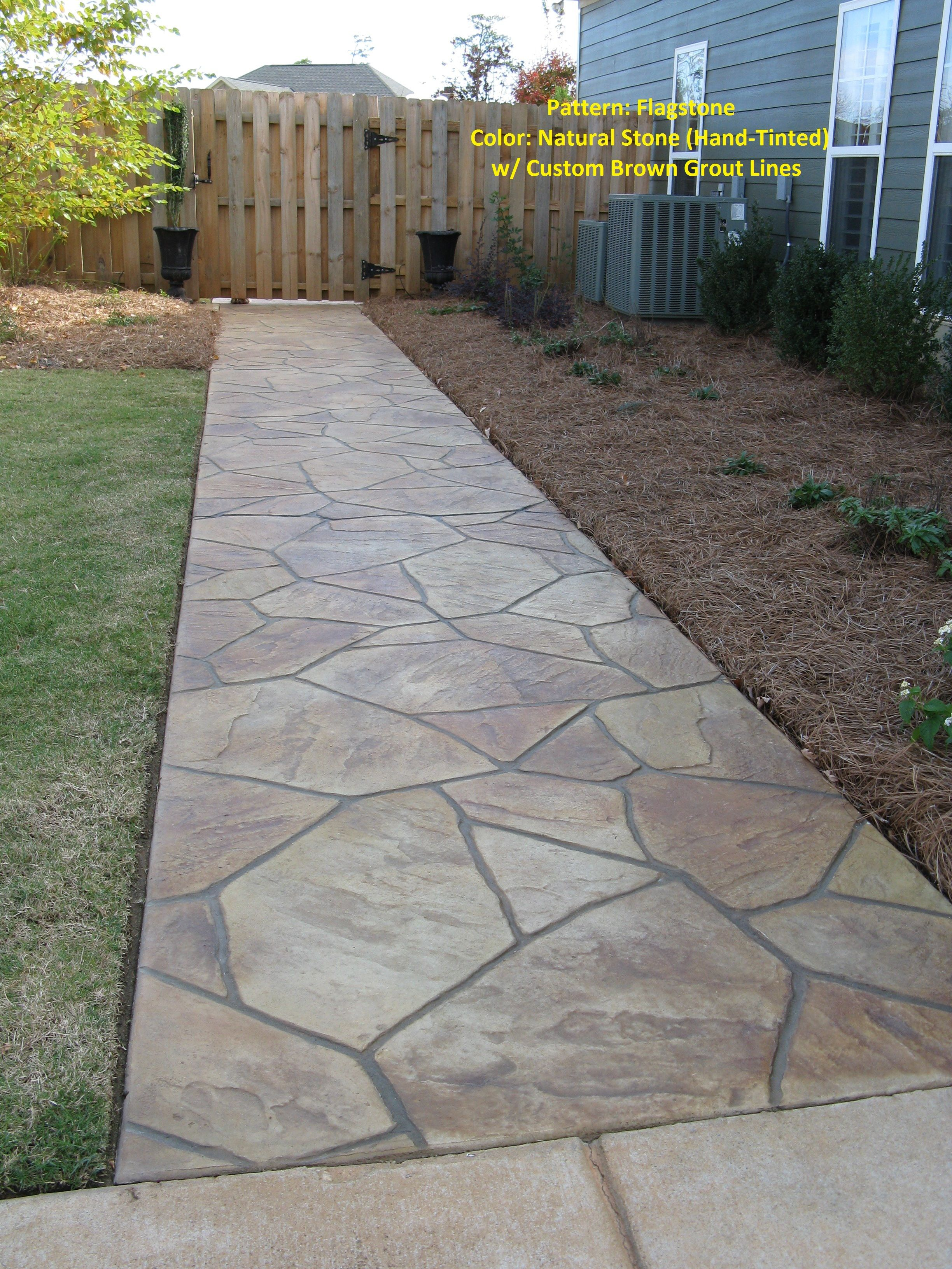 A rustic man made Flagstone paver walkway Yardmasters Landscapes