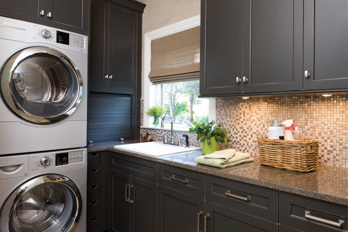 Traditional Laundry Room remodel with dark gray cabinets from Dura Supreme Cabinetry