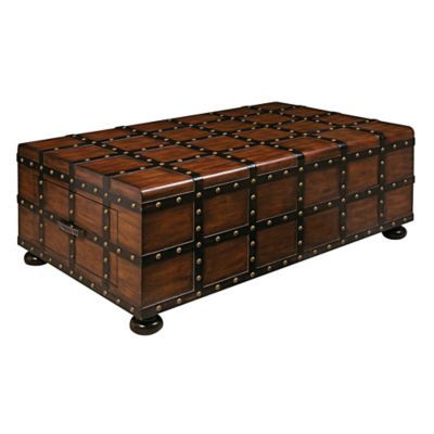 Pulaski Steamer Trunk Cocktail Table Brown is part of Cool Home Accessories Coffee Tables - This oldfashion styled Pulaski Steamer Trunk Cocktail Table exudes a rich, masculine tone  Crafted from wood in a warm bourbon finish, it is contrasted with faux straps with brass nailhead trim