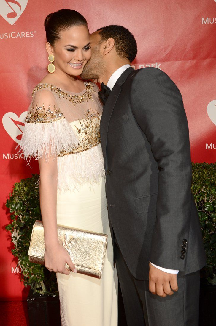 "Pin for Later: Chrissy Teigen and John Legend Bring New Meaning to the Term ""Relationship Goals""  John snuck a kiss on Chrissy's cheek at an LA event in February 2013."