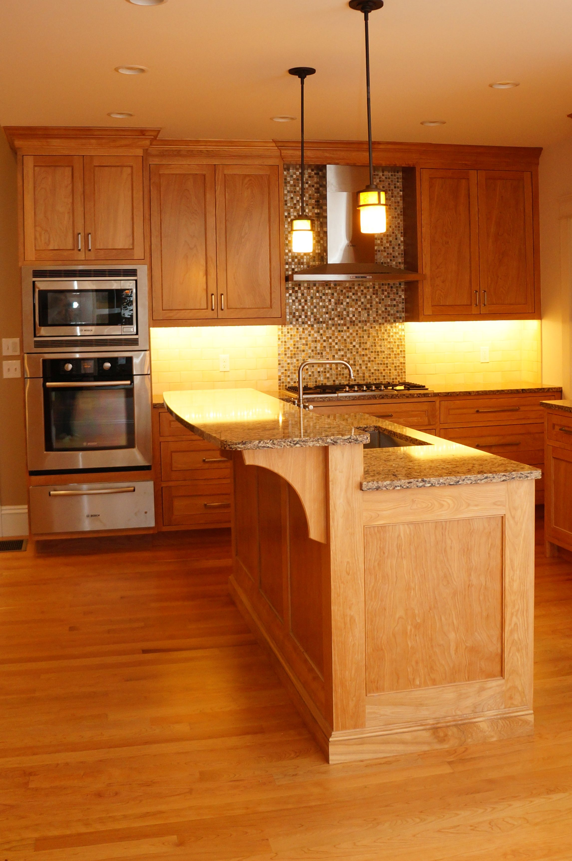Raised Island Counter Handcrafted By Taylor Made Cabinets Leominster Ma Serving Machusetts For Fine Custom Cabinetry
