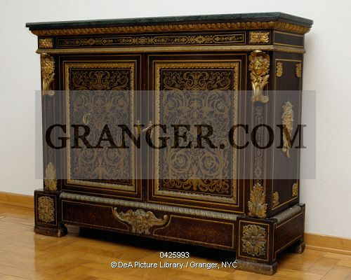 This is a Granger licensable image titled 'DECORATIVE ARTS. Napoleon III style piece of furniture with gilt bronze and imitation Boulle inlays, France, 19th century Full credit: De Agostini / A. Dagli Orti / Granger, NYC -- All Rights Reserved.' by Granger, NYC All rights reserved. You may not copy, publish, or use this image except for sample layout ('comp') use only. You must purchase the image from Granger in order to use it for ANY other purpose.