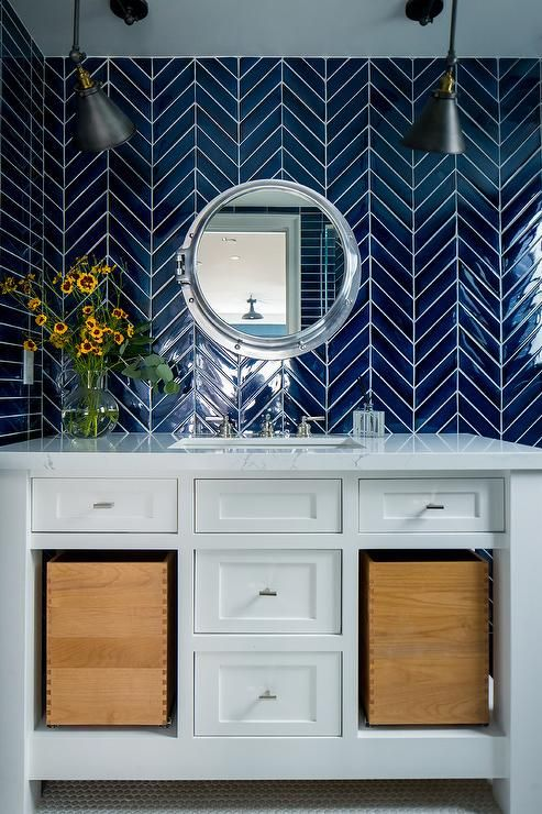 Chic Blue And White Bathroom Is Clad In Cobalt Blue Chevron Wall Tiles Lit By Two Matte Black Swing A Bathroom Backsplash Dark Blue Bathrooms Amazing Bathrooms