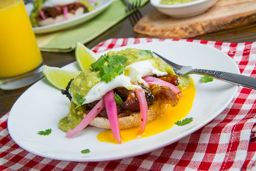 Carnitas Eggs Benedict.  I am not crazy for runny eggs, I poach the egg to firm, or use scrambled egg. The pickled onion makes this dish.  Enjoy!