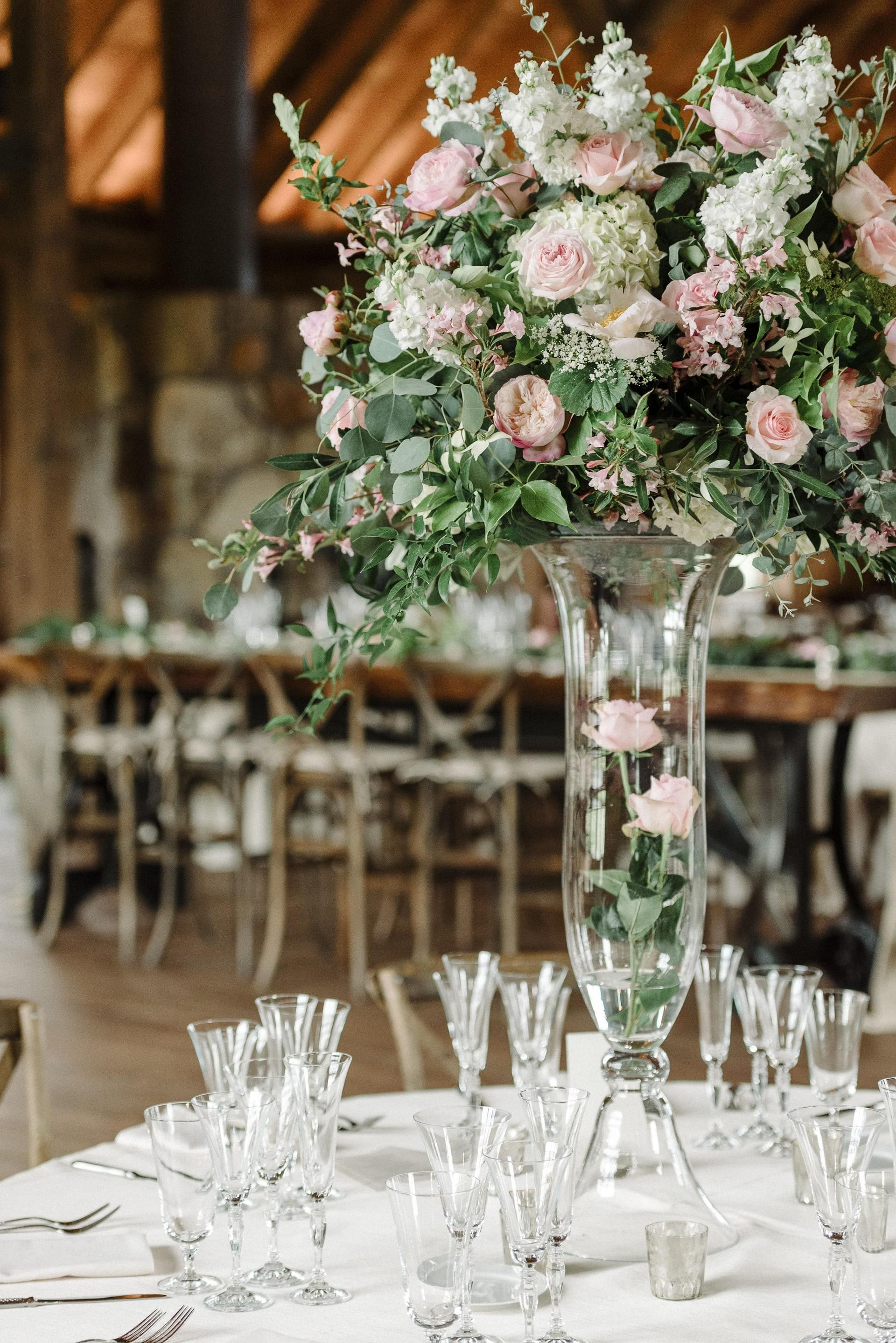 The smarter way to wed indoor wedding receptions indoor wedding tall glass vases large floral centerpieces indoor wedding reception decor light pink roses floridaeventfo Images