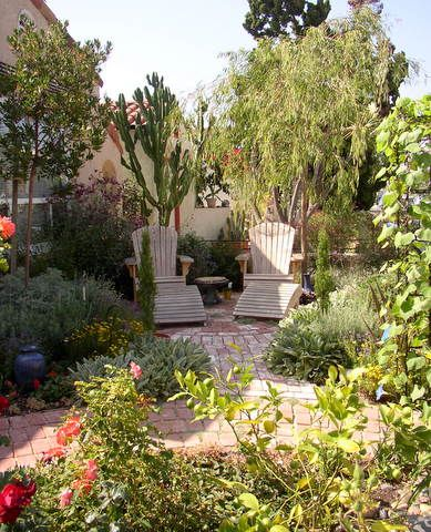 This is my own garden -  a tiny space with a couple of comfy chairs on a brick patio surrounded by lots of plants.  Hummingbirds are regular visitors as well as people.