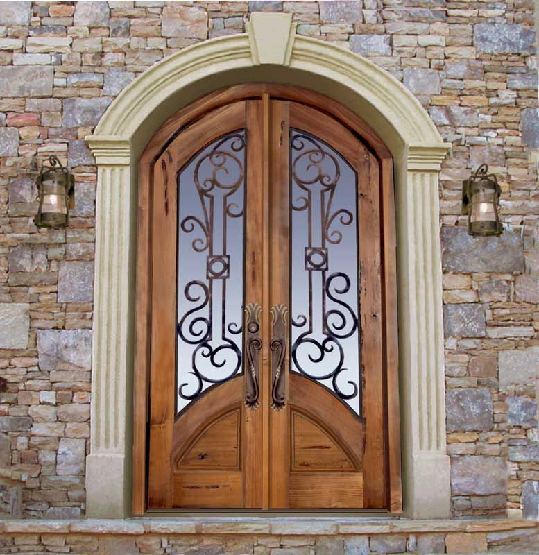 Great A Custom Castle Door. Beautiful Wood, Glass And Metal Front Entry. The  Decorative Metal Strengthens The Entry Door Appearance To Guard The House.