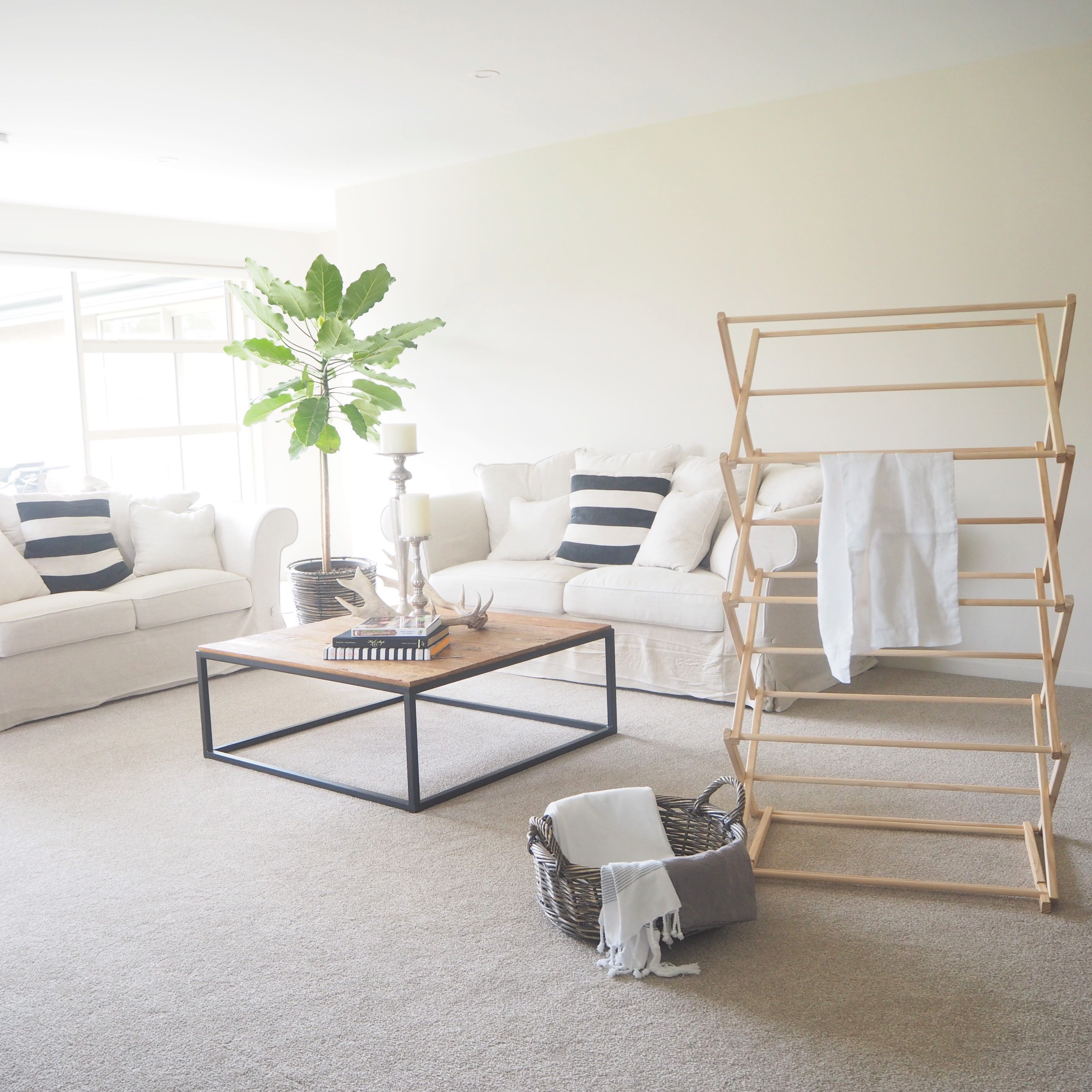 Washing Day! white wooden clothes dryer indoor plants