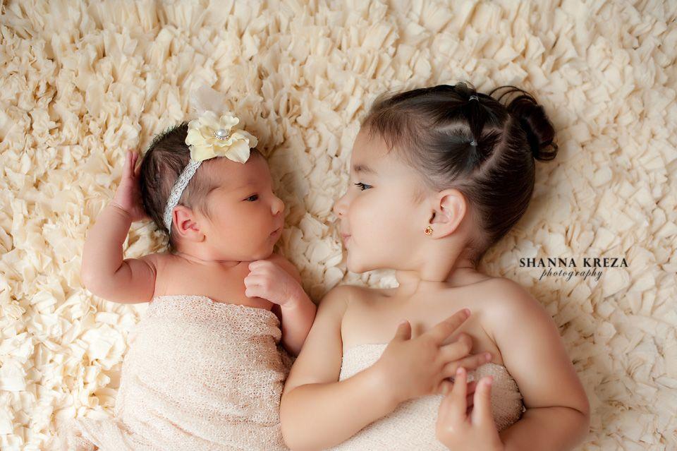 Newborn photos with big sister