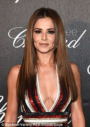 2f418b7f8 The 32-year-old former Girls Aloud songstress showed off a delicate new  tattoo on her chest as she rocked a perilously plunging jumpsuit