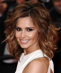 This full bodied hairstyle is thanks to the combination of layers cut all through the back and sides. The roots are teased to achieve maximum boost and encourages the waves and flicks through the sides making this look perfect for those with long face shapes. This hairstyle great for any occasion and will need product for hold and shine.