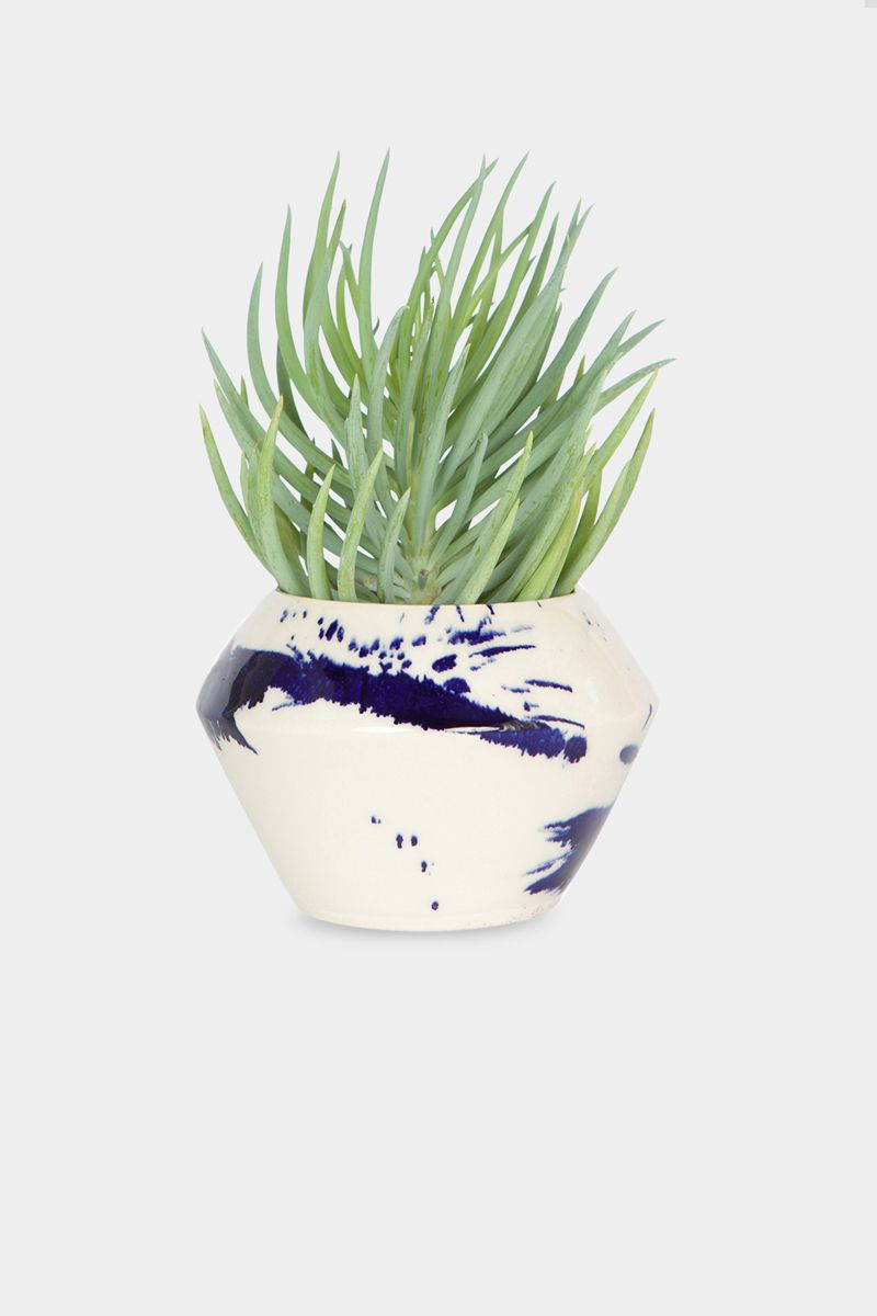 "Ceramic, hand thrown planter with indigo splatter.5"" x 5"" x 3.5""This item  is made to order. Please allow 3-5 weeks for shipping.Dishwasher safe."