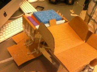Egg Drop Contraption Using A Cardboard Box Lined With