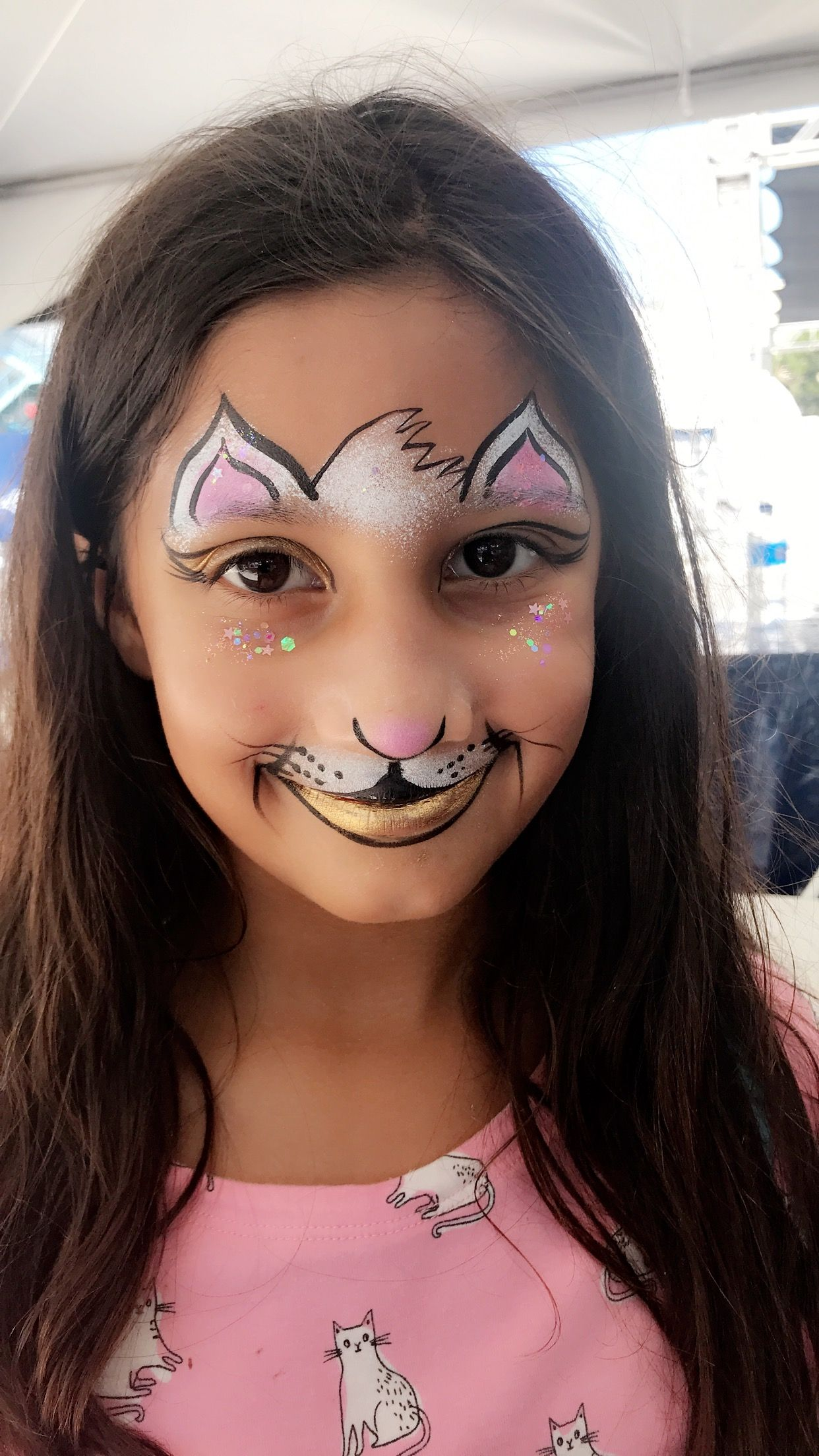 Easy cat face painting with metallic gold and chunky