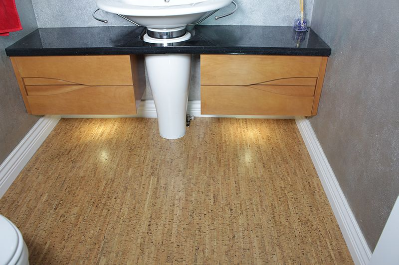 Bathroom Is Fitted With Cork Flooring And Cork Penny Tile On The