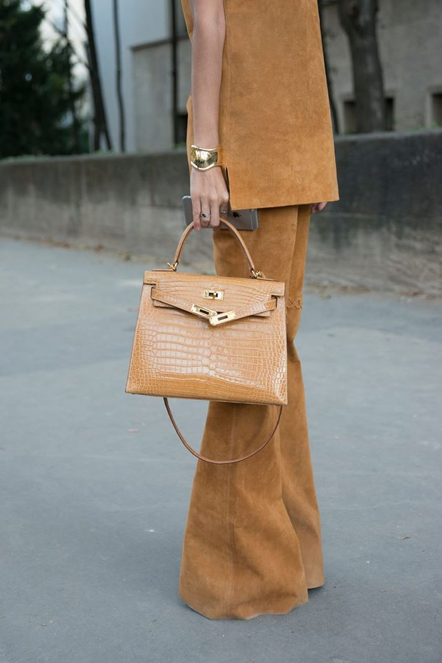 Brown suede tunic and flared bell-bottoms.