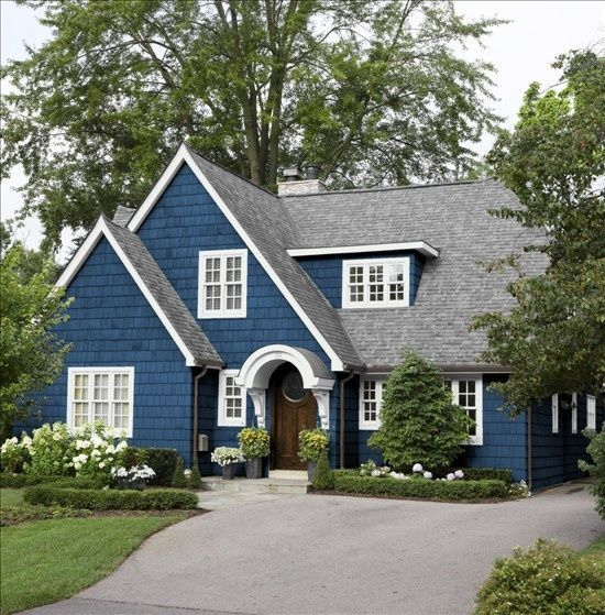 blue and white cape style house blue home white house