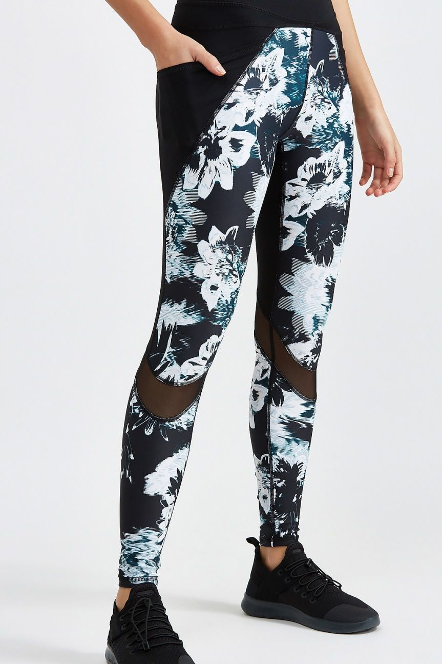 b15f1dd0a4ed1 Body Language Blade Legging: In addition to the funky floral pattern and  mesh panels, these fashion-forward leggings have thigh pockets large enough  for an ...