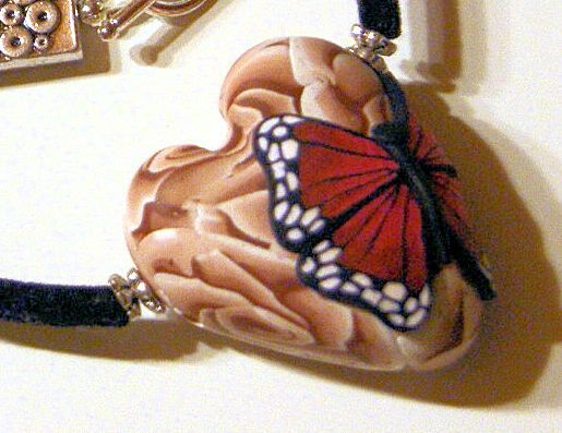 A butterfly on a heart with roses - Polymerclay by KVJ
