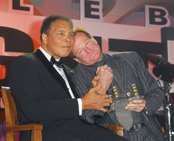 """We were shocked and sorry to hear of Robin's passing. He was a wonderful and loving human being who was always willing and ready to help others. Our prayers and sympathy go out to his family. May he rest in peace."" Muhammad Ali"