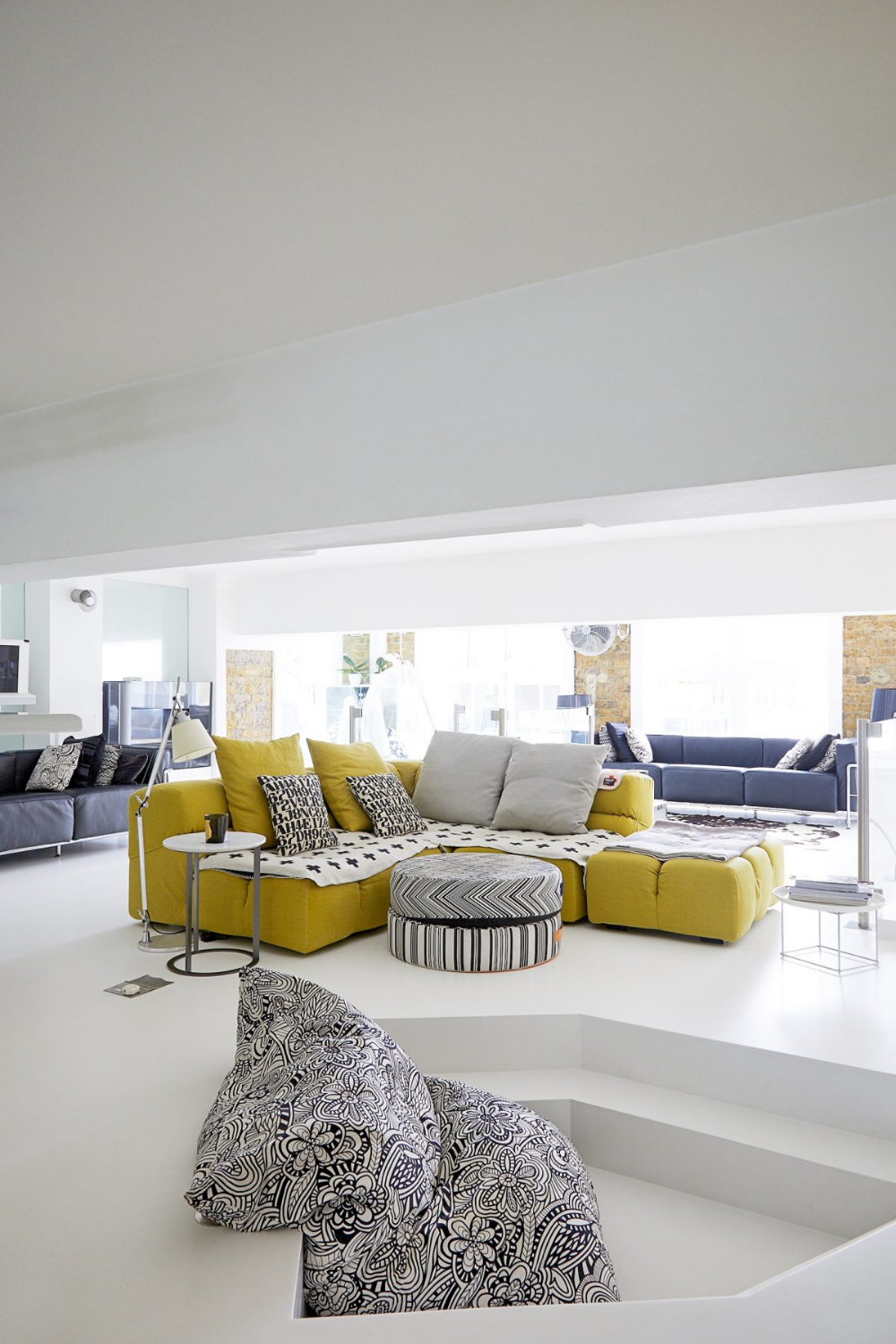 contemporary white living room design with mustard yellow
