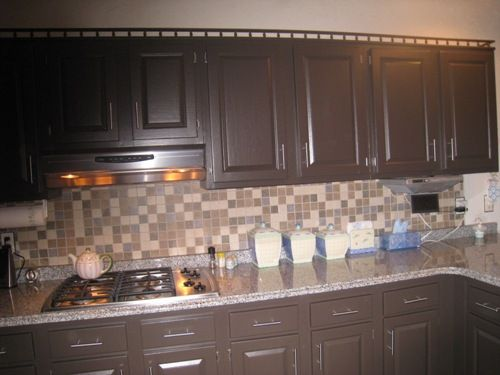 Home on pinterest media storage dark cabinets and wine for Brown painted kitchen cabinets
